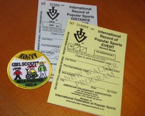AVA record books and a Girl Scout walking patch